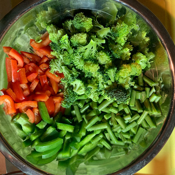 prepped vegetables. Broccoli, green beans, red and green bell pepper