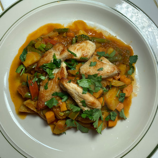 a tasty plate of vegetable chicken masala